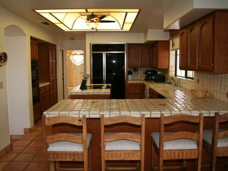 Goodyear house photo - gourmet kitchen jennair ceramic cktp, bulit in microwave/oven, wine cooler,