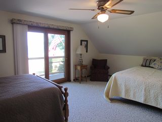 Oscoda house photo - Upstairs lakeside bedroom. One queen and one double