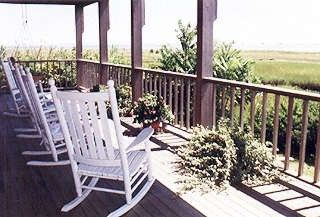 Chatham house photo - Lower mohogany decks with rockers & hammock swing, or adirondack azek recliners