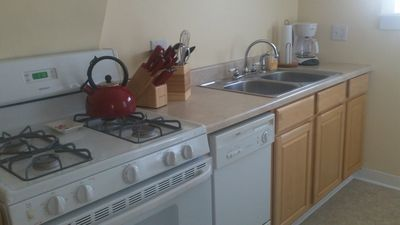 Kitchen w/gas range, dishwasher, fridge, microwave, etc - Swan at Stonehearth