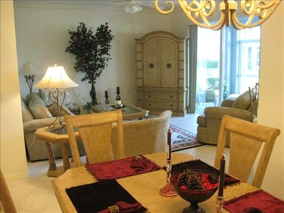 Fort Myers condo rental - Open Concept; Living Room/Dining Room. Living Room leading to enclosed Lanai.