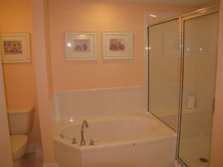 Fort Walton Beach condo photo - Guest bath toilet, garden tub, and walk-in shower with 6-way shower/massage head