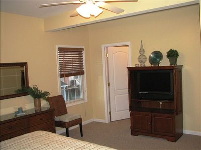 Alternate view of master bedroom, with large flat screen TV & walk-in closet.