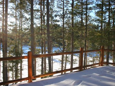 View of lake in winter from back deck (300 degree lake views surround the home)