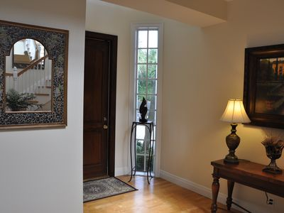 Entrance to the home with fine art, beautiful carpets & high quality furniture