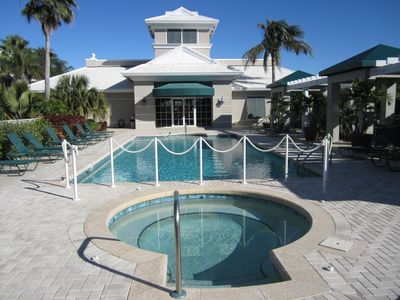 Clubhouse with pool, hot tub and tennis court