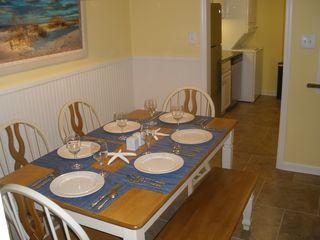 St. Simons Island condo photo - The dining area can be used for formal dining or seating for a good board game.