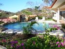 Pool and bougainvilleas. Kids will have a big time playing under the waterfall. - Playa Hermosa house vacation rental photo