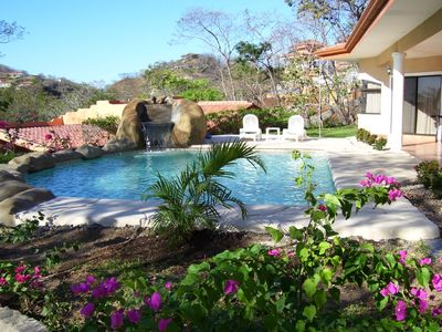 View of pool and bougainvilleas