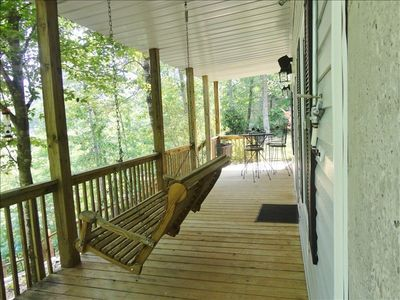 Lakefront sheltered deck with swing perfect for reading, relaxing and picnics