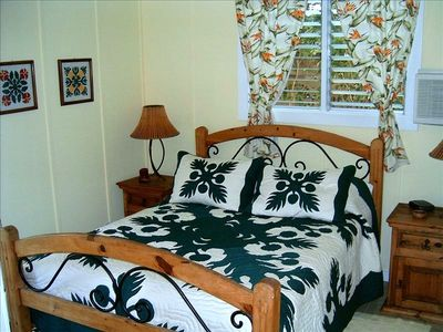 One bedroom decorated with a Hawaiiana flare