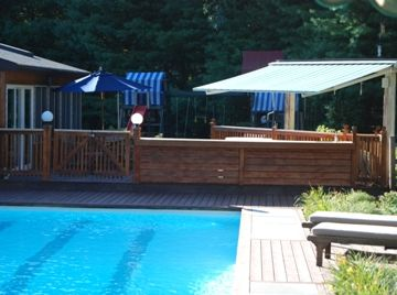 View from pool of bar/deck and sunroom