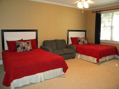 Large secondary bedroom with two queen-size beds and sitting area with full bath