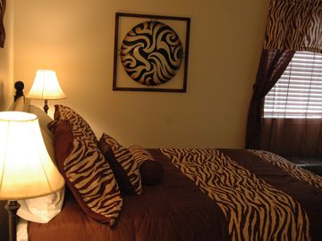 Master Bedroom with queen-sized bed, 32-inch flat screen TV and DVD player..