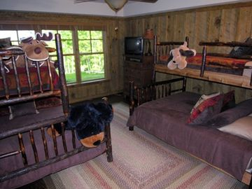 Childrens bedroom with two twin over queen bunk beds