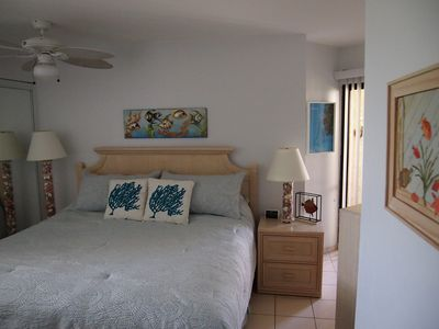 Our bedroom with king sized bed and enclosed patio beyond