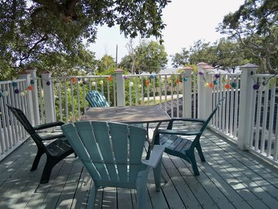 Enjoy morning coffee or evening wine on the expansive deck with friends.