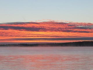 Burt Lake cabin photo - Incredible sunrises, are a great start to your day...
