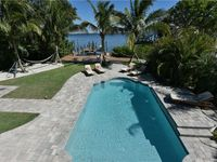 Direct Canal Front 4 bed/3 bath with private heated pool and dock!