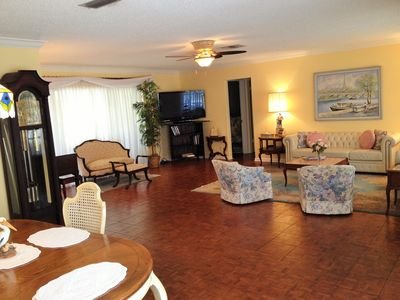 Expansive, open living/formal dining area.  Huge flat screen TV!