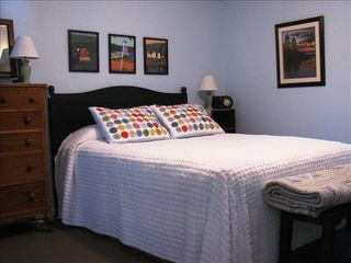 Biddeford apartment photo - Restful bedroom, cozy quilts, adjoining bath