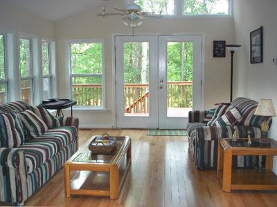 Very Bright and Vaulted Sunroom with French Doors Open to Deck