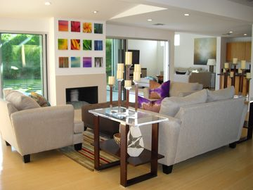 Living room with walls of glass.
