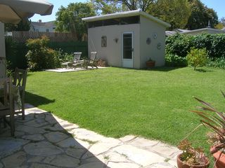 Santa Barbara bungalow photo - Looking out to the 2d patio by storage shed; young productive Hass avocado tree.