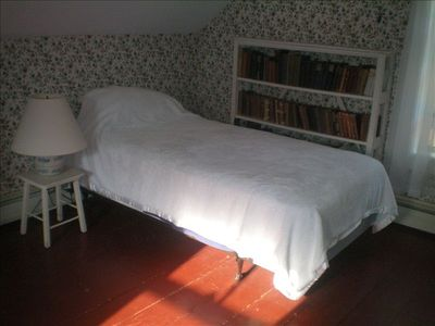 One of two identical single beds in upstairs room also used as study.