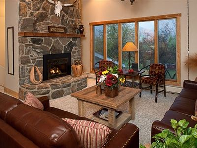 Relax by the fire in the living room.  Views of scenic cattle ranch below.