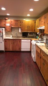 Killington house rental - Our very well equipped kitchen now has granite counter tops and a wooden floor.