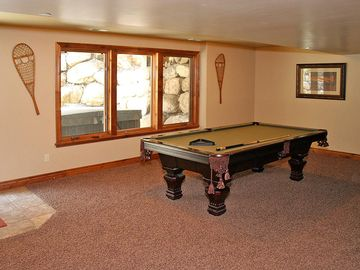 Basement game area that walks out to Hot Tub