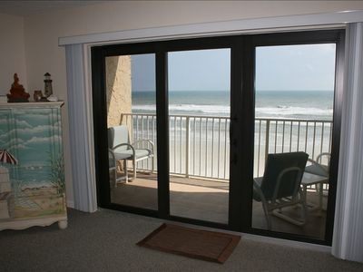 New Smyrna Beach condo rental - View of Balcony from Living Area - 4 chairs and 2 side tables