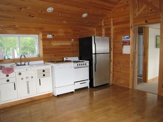Jay Peak house photo - Functional kitchen with microwave, refrigerator, gas stove, and coffeemaker!