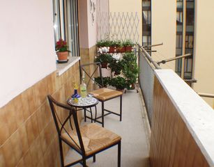 Trastevere area condo photo - The foyer chairs and table can be easily moved out for the Roman sun, wine, etc.