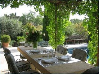 Gordes house photo - Dining under the shaded pergola, next to kitchen door.