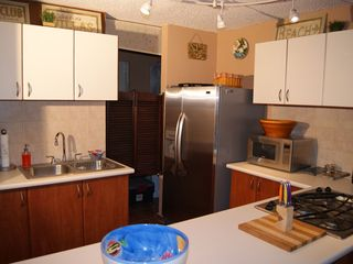 Cabo Rojo apartment photo - Fully equipped kitchen. Laundry has washer-dryer combo.