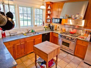 Chilmark house photo - Chef's Kitchen Is Fully-Equipped With Commercial Stainless Steel Appliances, Brazilian Granite Countertops & Butcher Block Prep Table