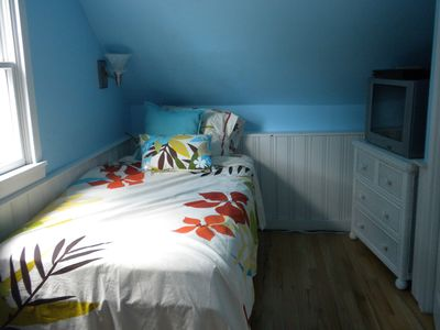one of the upstairs bedrooms with two twin beds