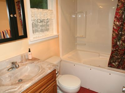 West apartment bathroom with Jacuzzi bathtub and shower