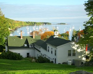 Camden house photo - Rear view of our home with sailboat-studded harbor at sunset. Lighthouse.