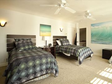 The Quattro Bedroom sleeps four guests comfortably in four separate twin beds.