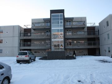 The building at Fljótsmörk 6, the apartment is on 2nd level, first door to left.