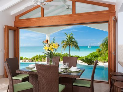 Dining area overlooking the pool and beach