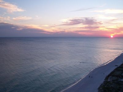 Beautiful view of the sun setting from the direct gulf front condo balcony