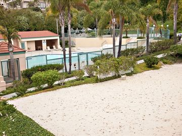 Sand Vollyeball Court with Pool in background
