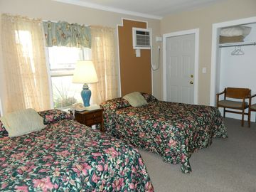 Walk-thru bedroom with 2 double beds.