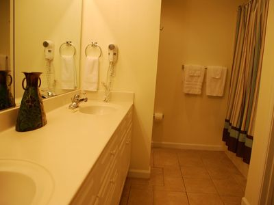Spacious Master Bathroom with Whirlpool Tub and Wall Mounted Hair Dryer