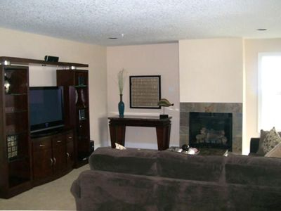 Fireplace in living room, with a sectional couch !