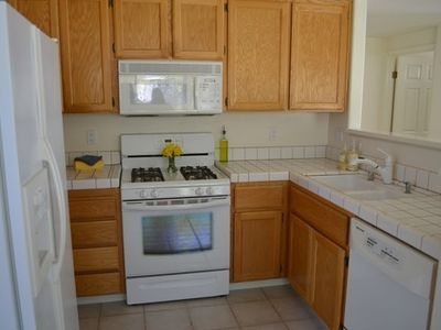Kitchen:  4 burner gas stove, oven, microwave, refridge, dishwasher & disposal.